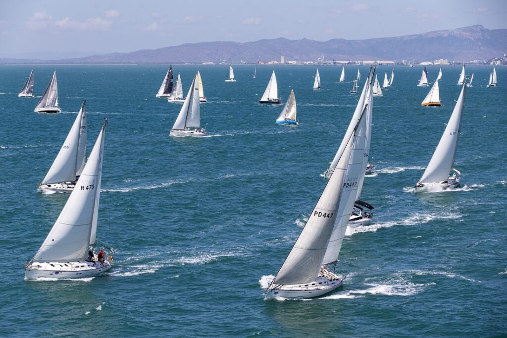 Aerial shot of a fleet of boats sailing upwind