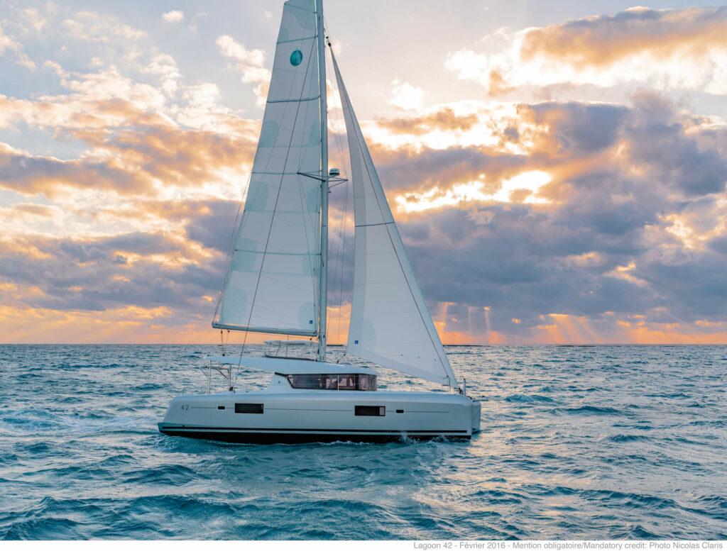 Lagoon 42 sailing at sunset