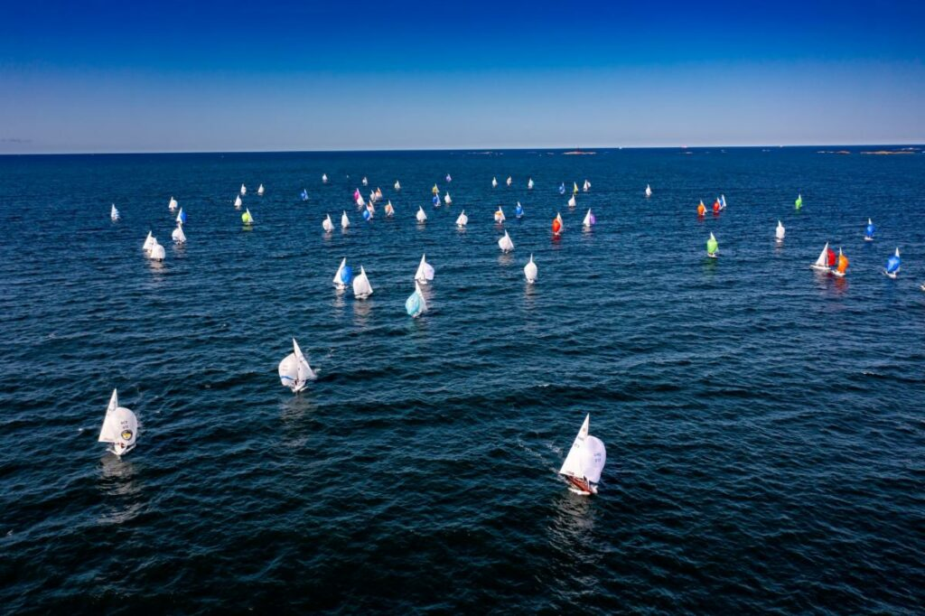 Aerial shot of Dragon fleet sailing downwind with the spinnakers.