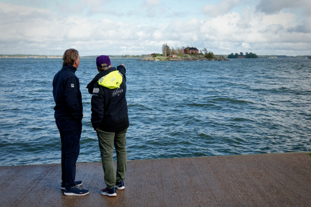 Sailors looking out onto the water