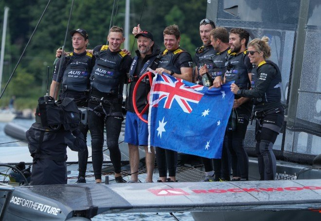 The Australian SailGP Team posing for a photo with Frederik, Crown Prince of Denmark.
