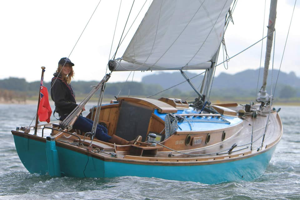 Katie McCabe sailing on her yacht (blue hull)