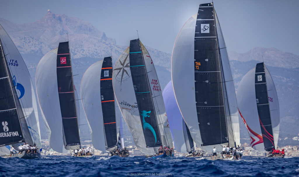 The fleet heading downwind with spinnakers