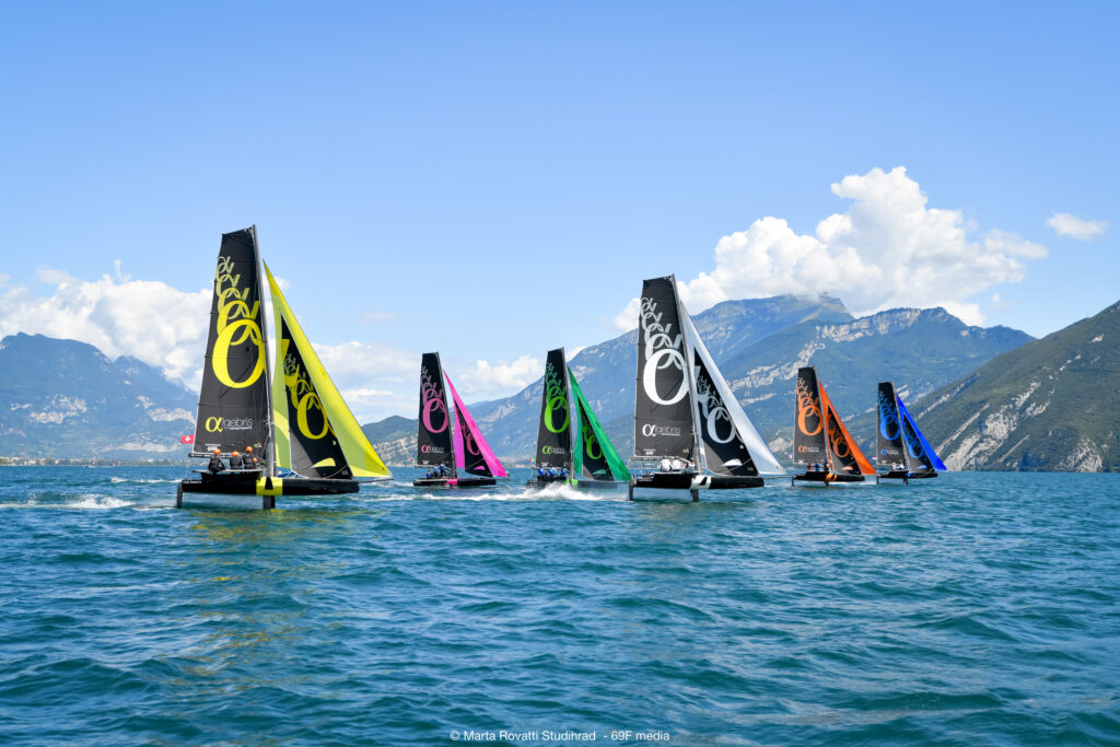 The fleet on a spinnaker reach with the mountains in the background.