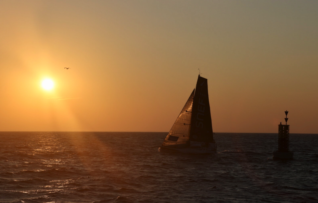 Boat sailing into the sunset.