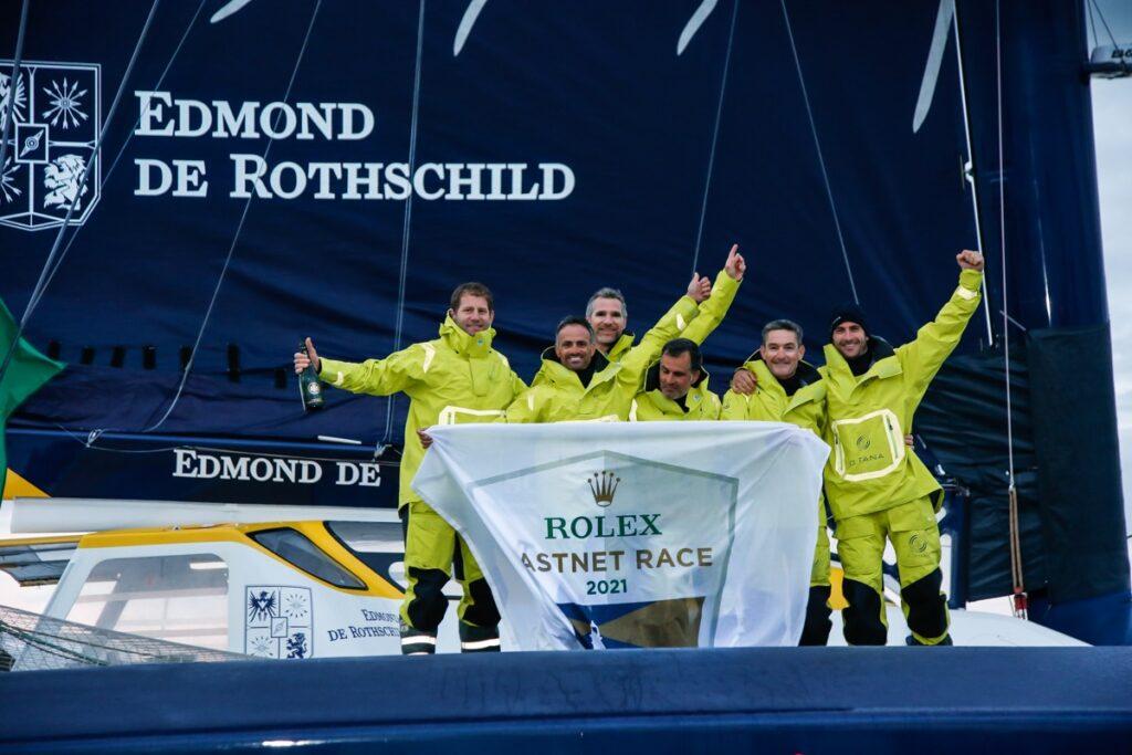 Maxi Edmond de Rothschild team celebrating their win on the boat
