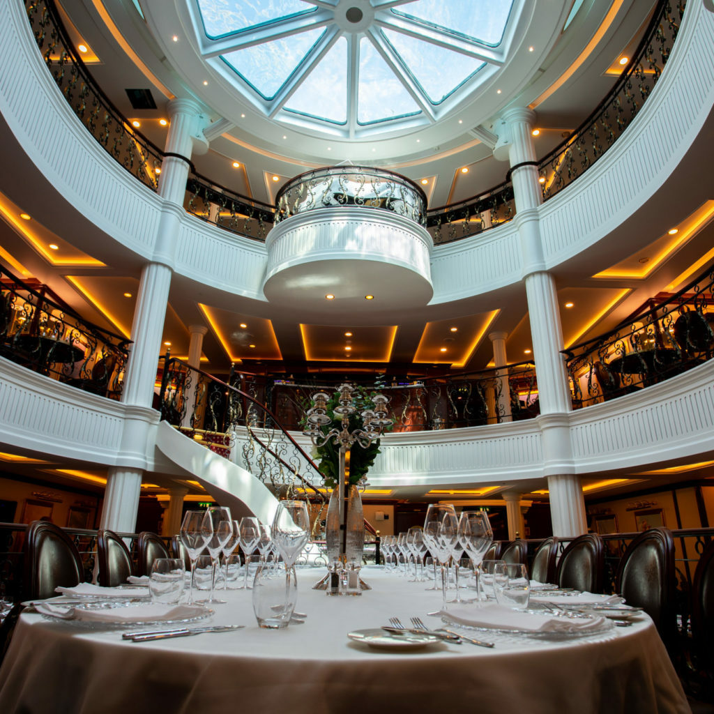 Inside the sailing ship in the dining room. The glass ceiling window is the bottom of the swimming pool.