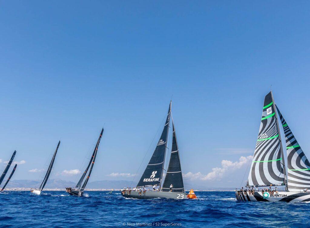 The fleet sailing upwind, led by Quantum Racing.