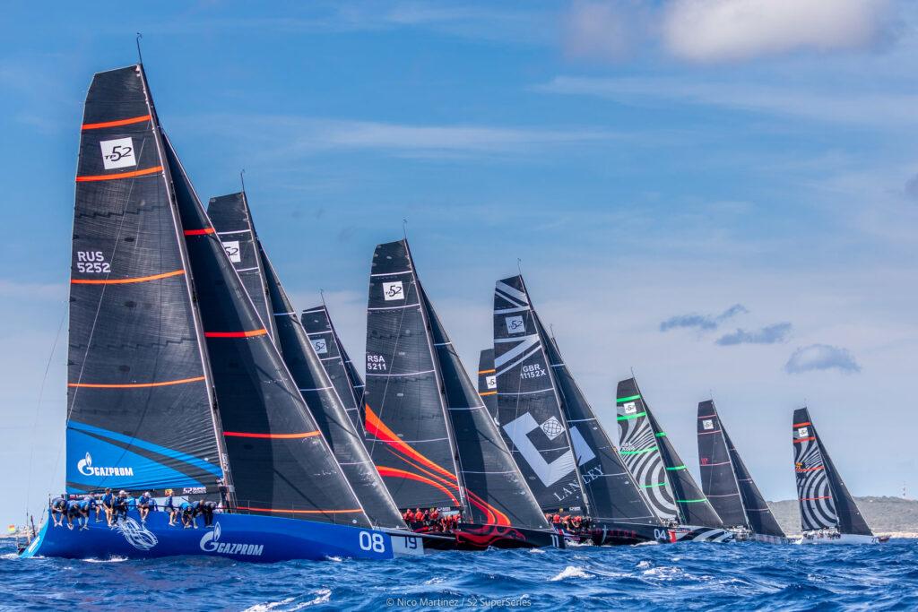 Fleet sailing upwind after start.