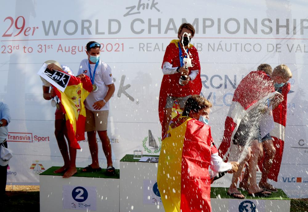 The winners celebrating on the podium