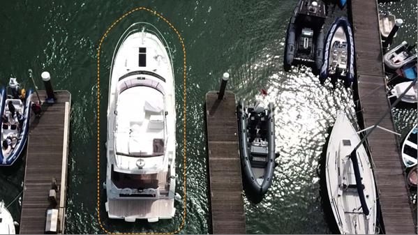 Aeiral shot of a big motorboat docking.