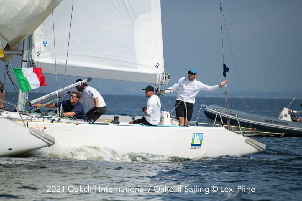 Chris Poole and his Riptide Racing crew alongside their competitor.