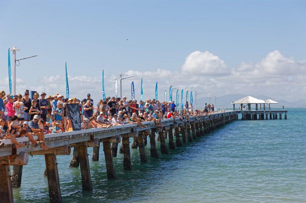 Spectators await the race on the pier.