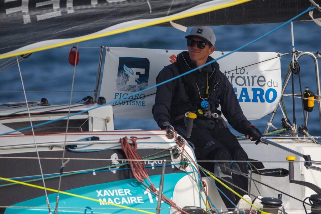 Xavier Macaire steering his boat.