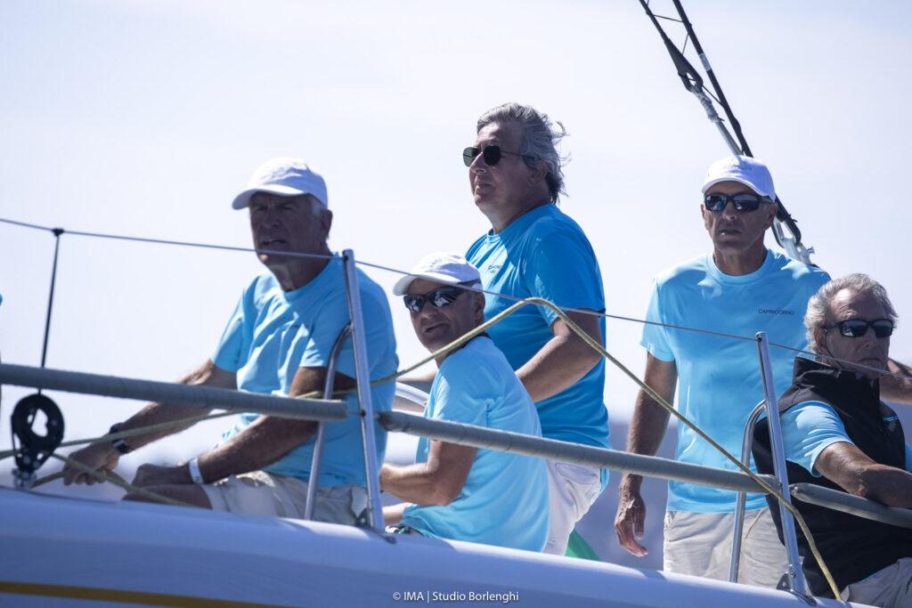 Alessandro Del Bono helming Capricorno with Flavio Favini to the right.