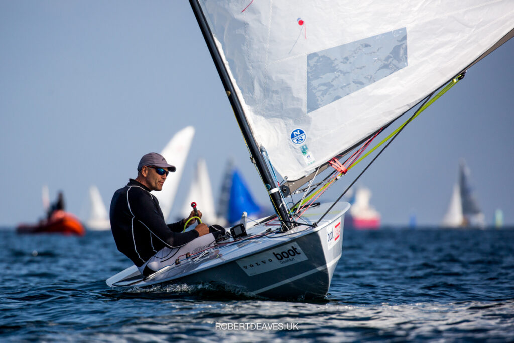 Andre Budzien sailing downwind on flat water.