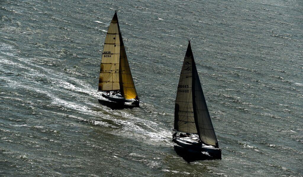 Aerial shot of 2 yachts reaching.