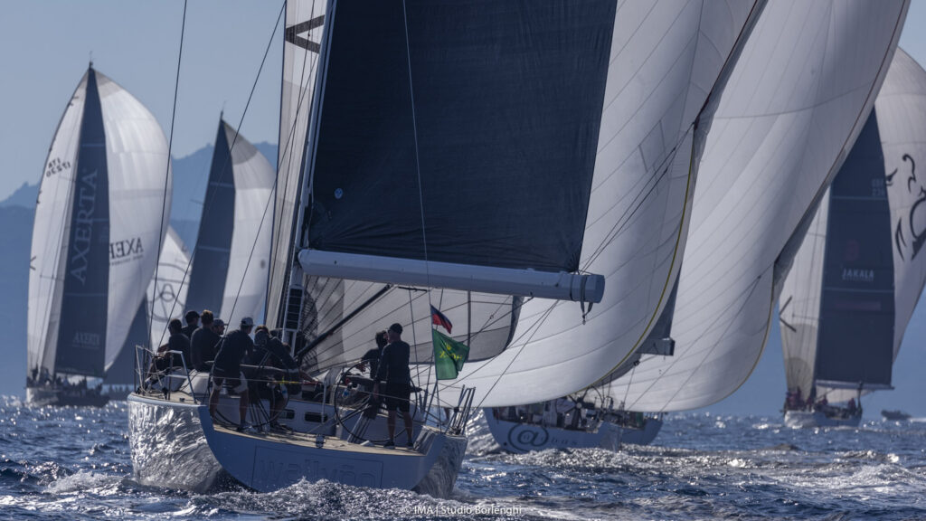 The sterns of the Mini Maxi fleet as they sail on a kite run.