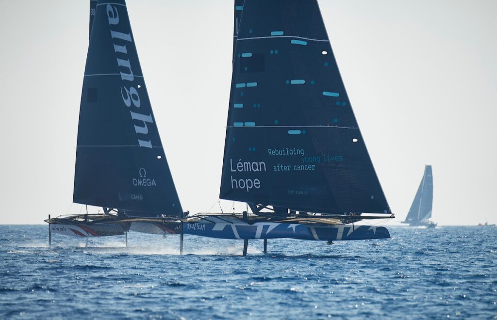 Alinghi and Realteam Sailing next to each other.