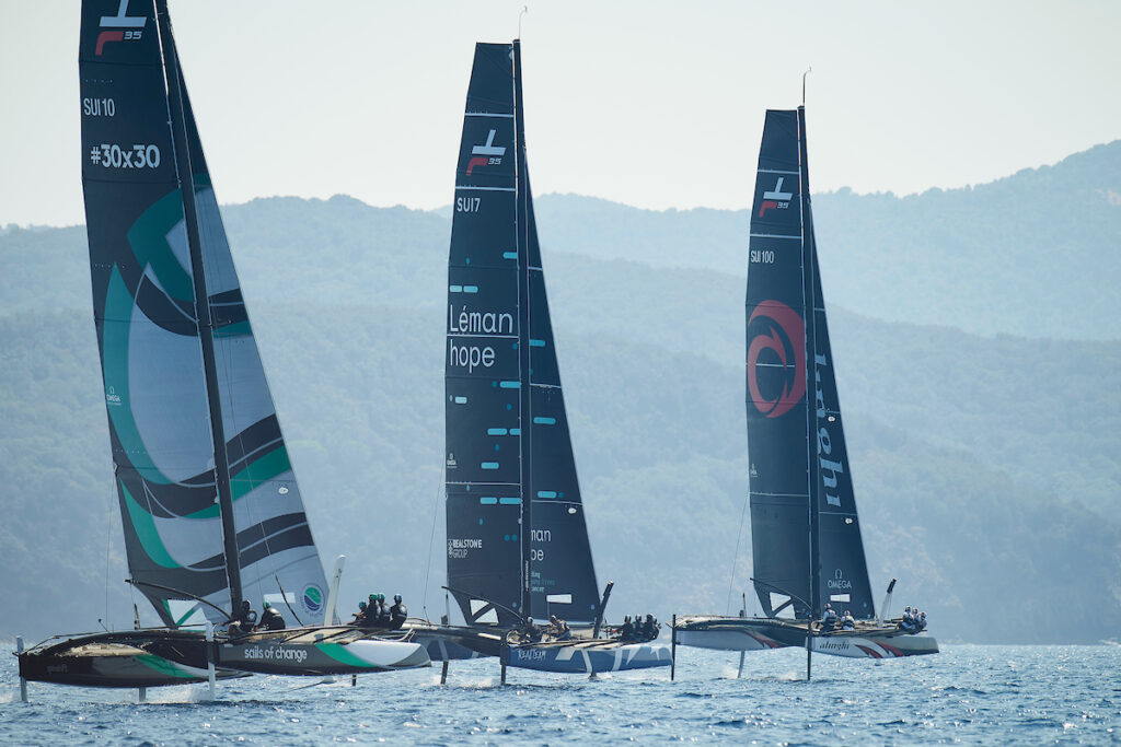 Three boats sailing upwind.