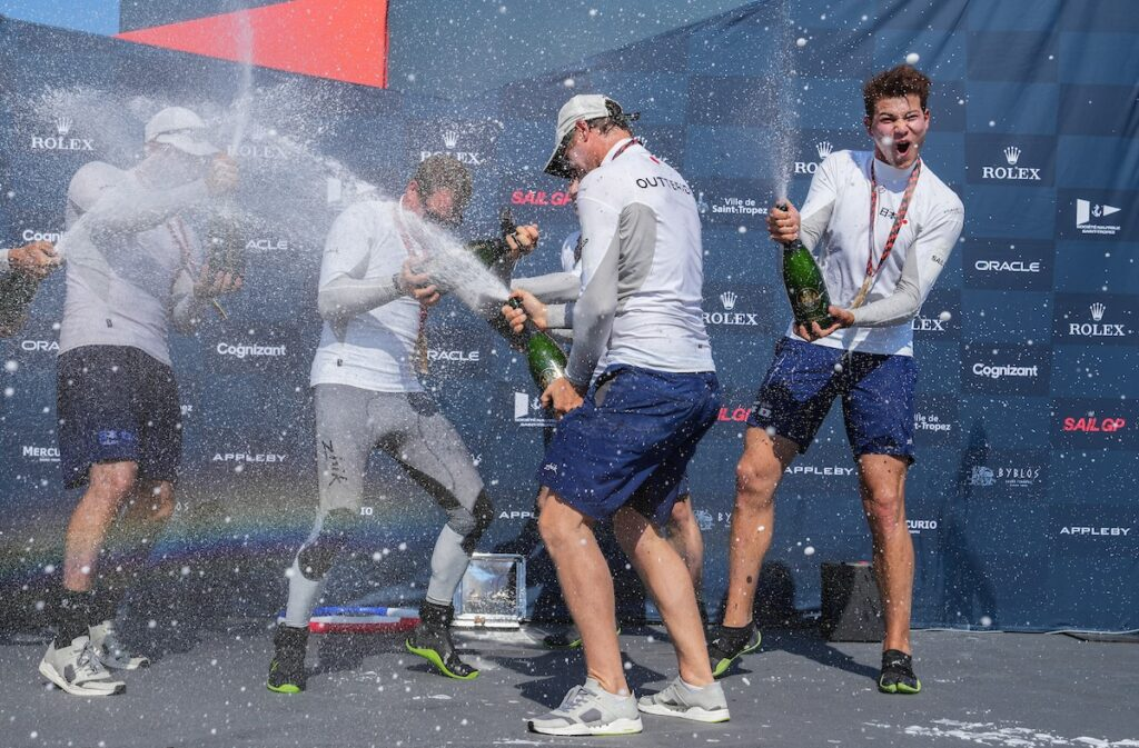 The Japan Team spraying champagne on the stage.