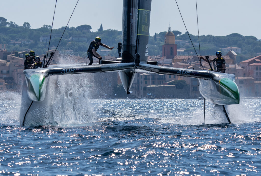 Australia sailing straight to the camera, water coming off their foils.