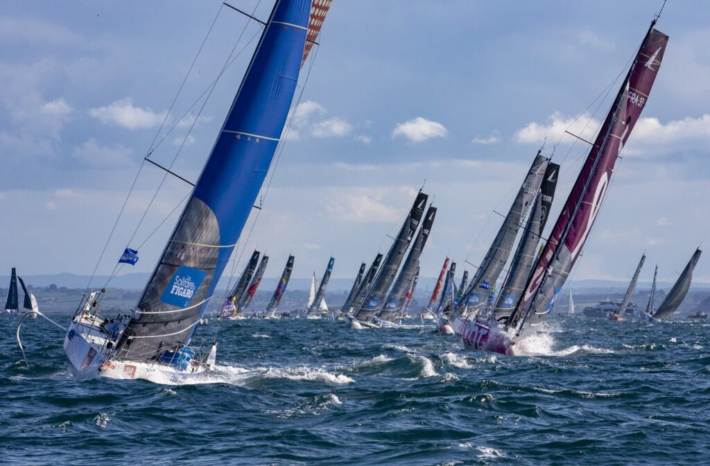 The fleet sailing upwind towards the camera, shortly after the race start.