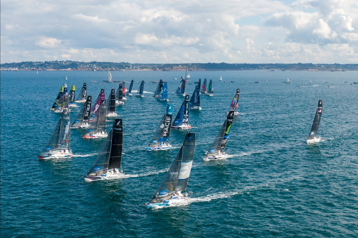 Aerial shot of the fleet sailing upwind after the race start.