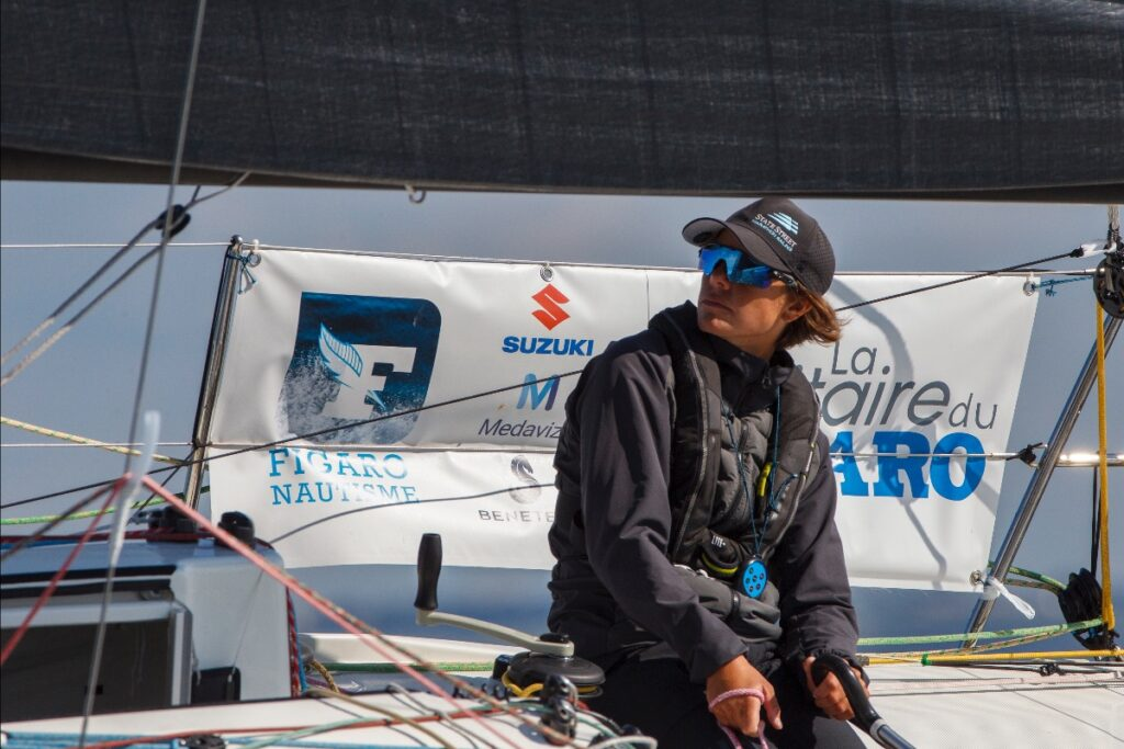 Francesca Clapcich steering, looking forward at the race course.