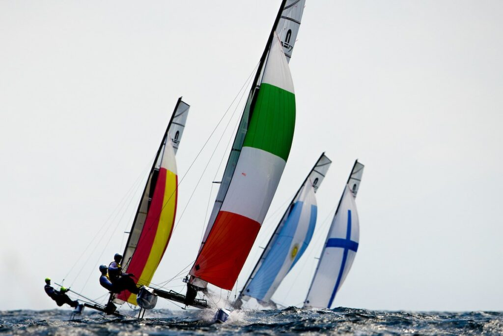 Nacra 17s on a kite run, being led by the Italians.