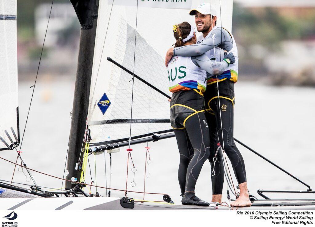 Lisa Darmanin and Jason Waterhouse embracing on the boat at the Rio Olympics.