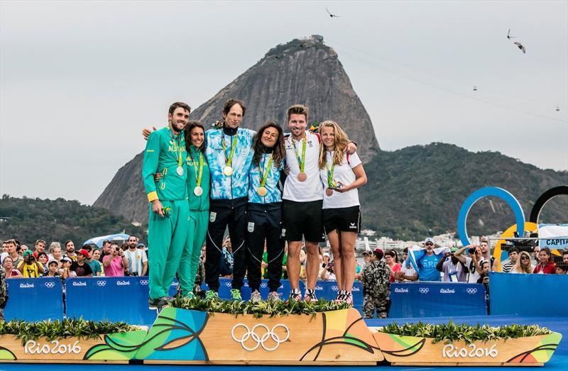 Jason Waterhouse and Lisa Darmanin (AUS), Santiago Lange and Cecilia Carranza Saroli(ARG) and Thomas Zajac and Tanja Frank (AUT) on the podium at the Rio 2016 medal ceremony.