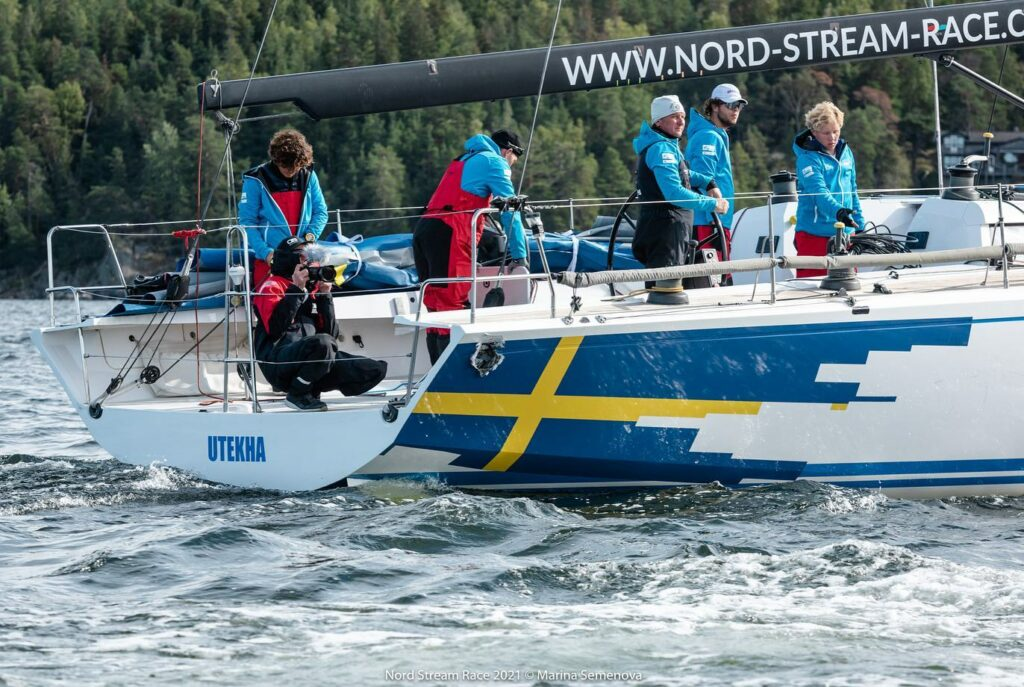 The Swedish team motoring home with a ball sized hole on the side of their boat, right near the stern.