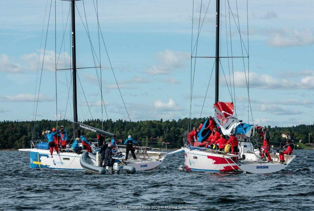 The Danish yacht's bow sprit sticking into the stern of the Swedish yacht's.