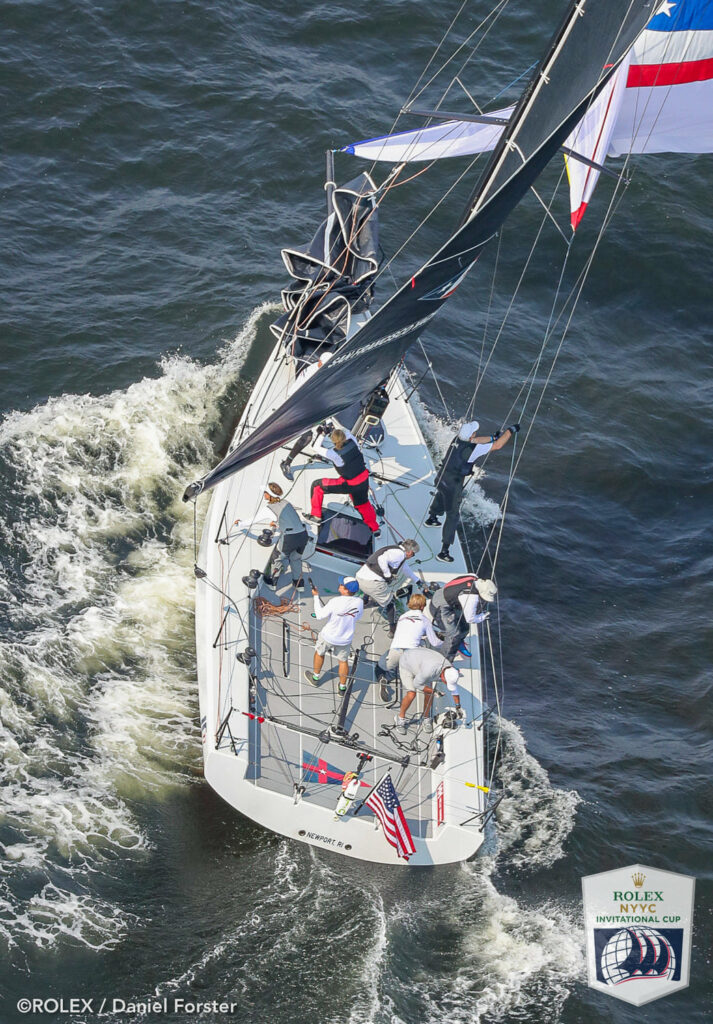 Aerial shot of an American yacht gybing the kite.