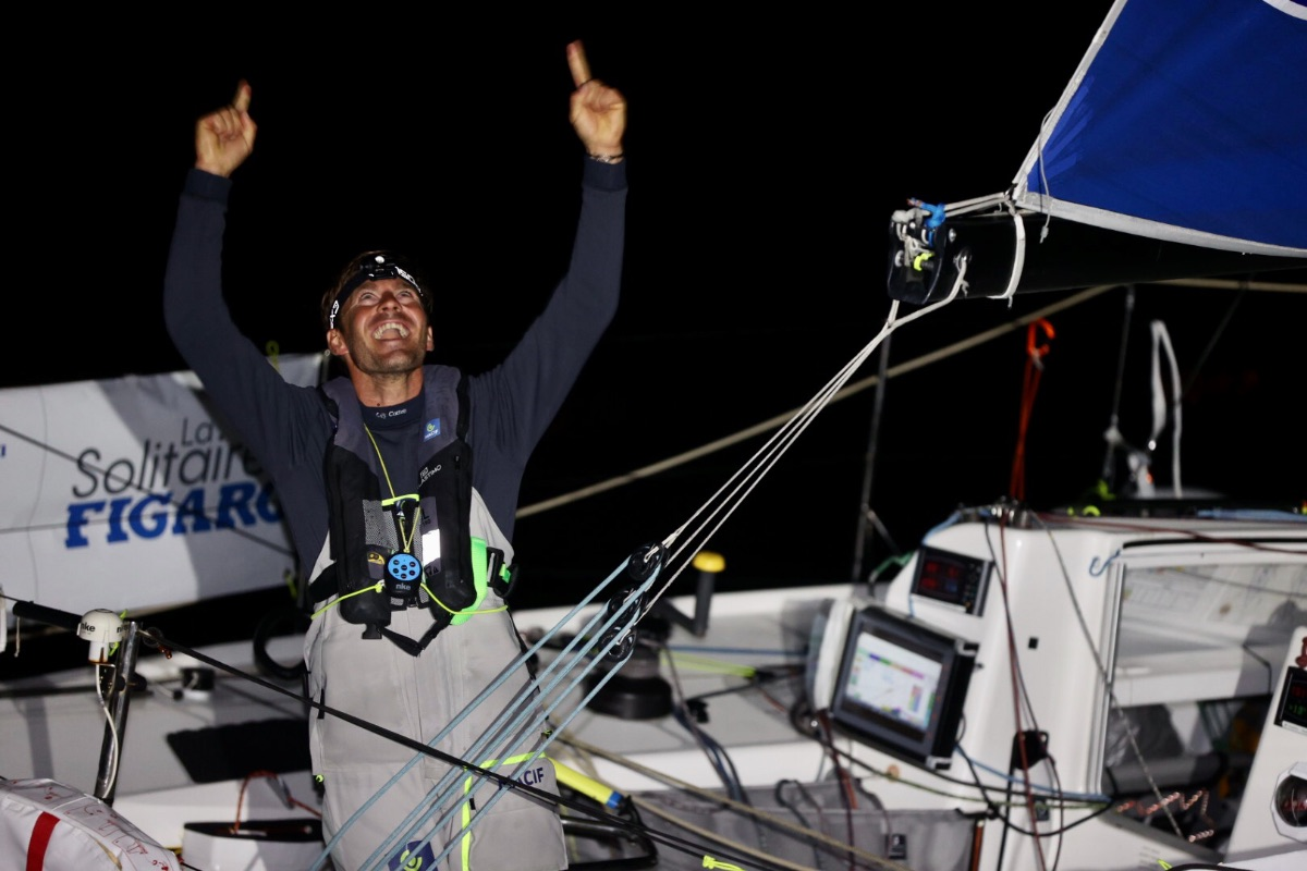 Pierre Quiroga celebrating win on his boat at night.
