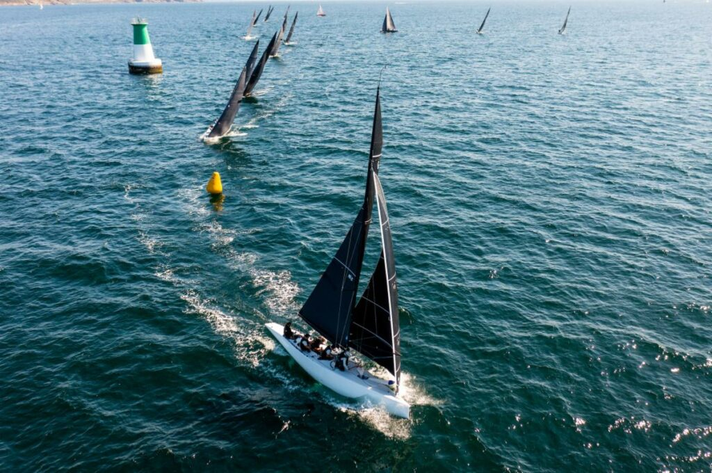 Aerial shot of the fleet rounding a yellow marker.