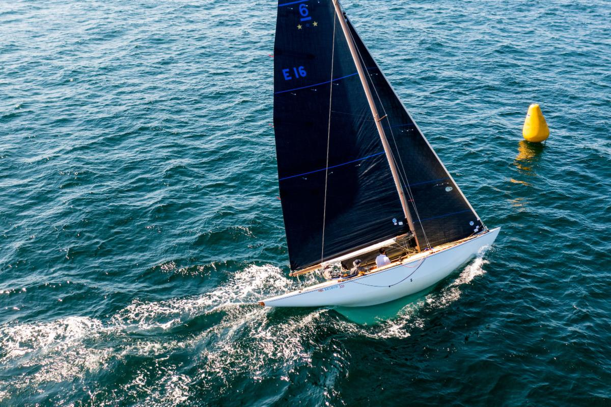 Aerial shot of a yacht sailing upwind.