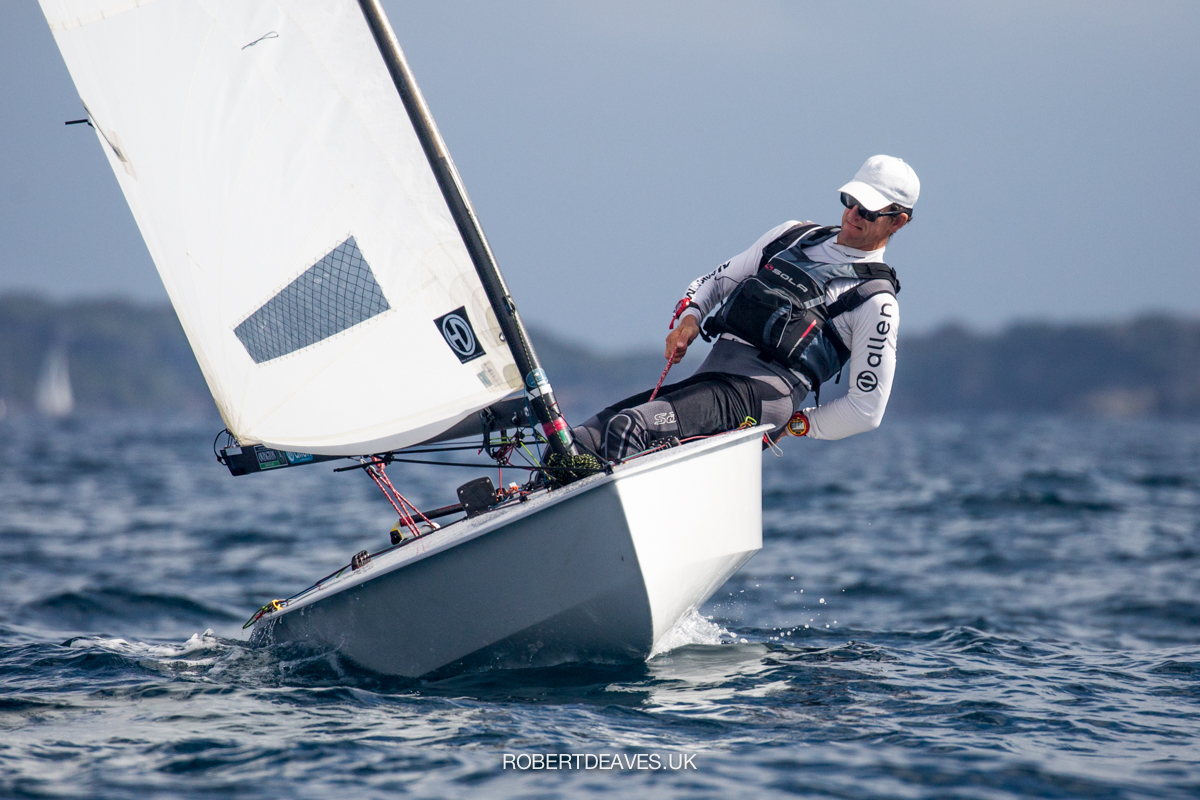 Nick Craig finishing a tack, hiking, sailing upwind.