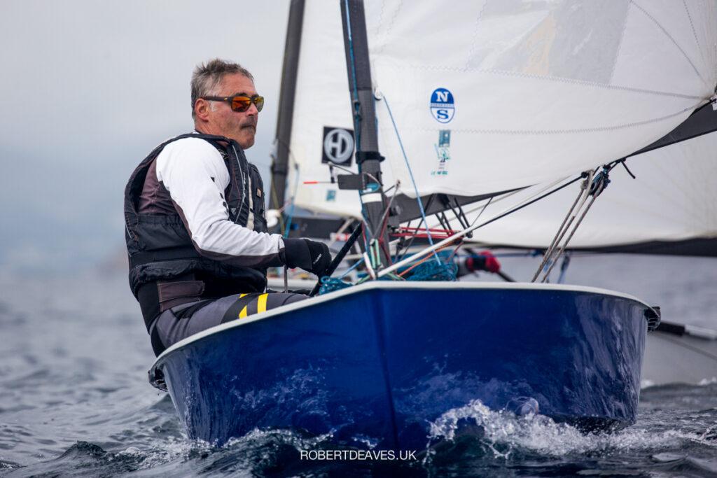 Laurent Hay sailing in his boat (blue hull).