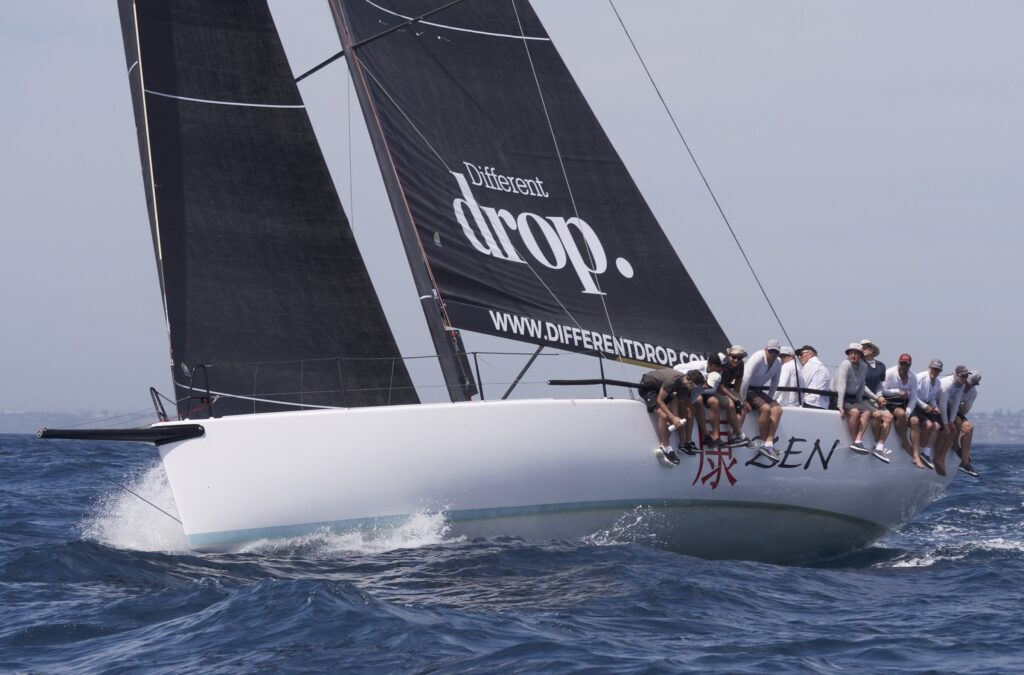Zen sailing upwind, crew leaning over the side.