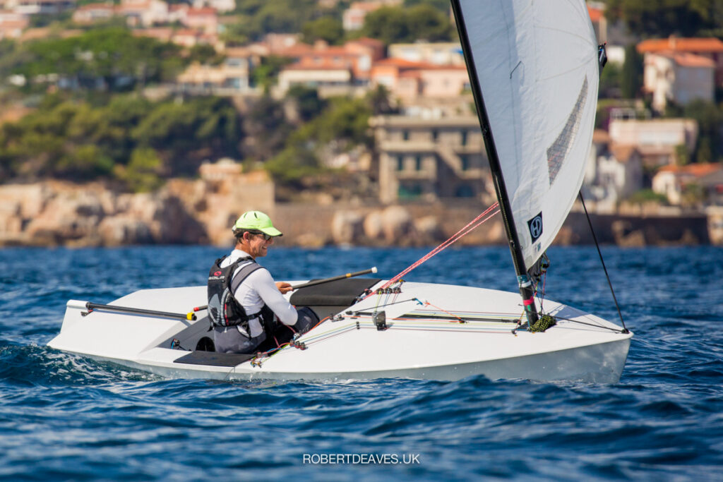 Nick Craig sailing downwind, healing the boat the windward.