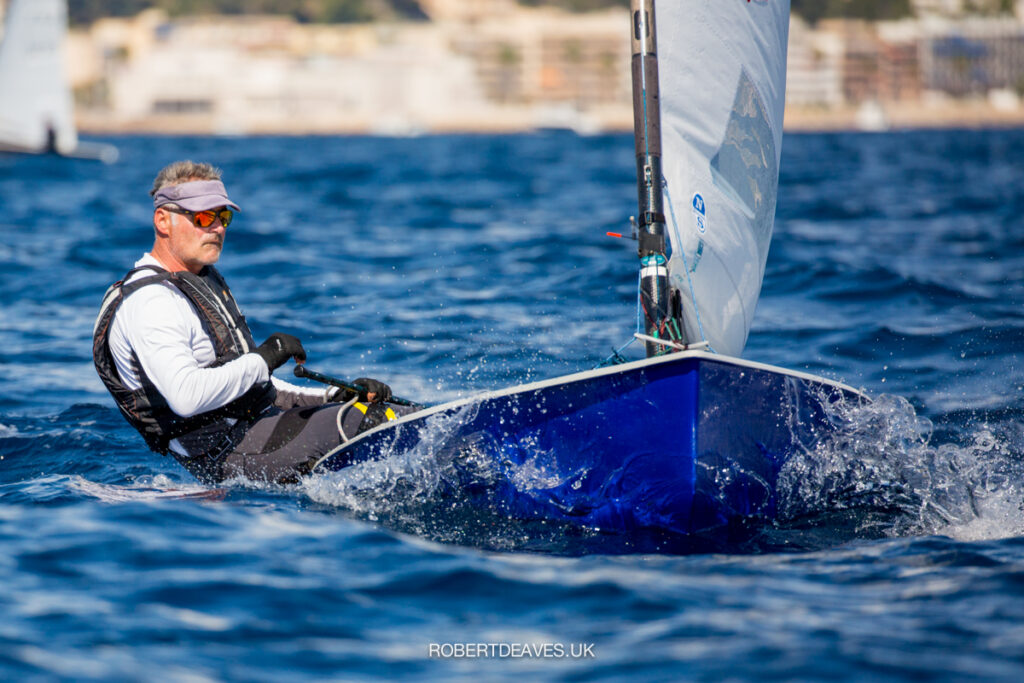 Laurent Hay sailing upwind towards the camera (blue hull).