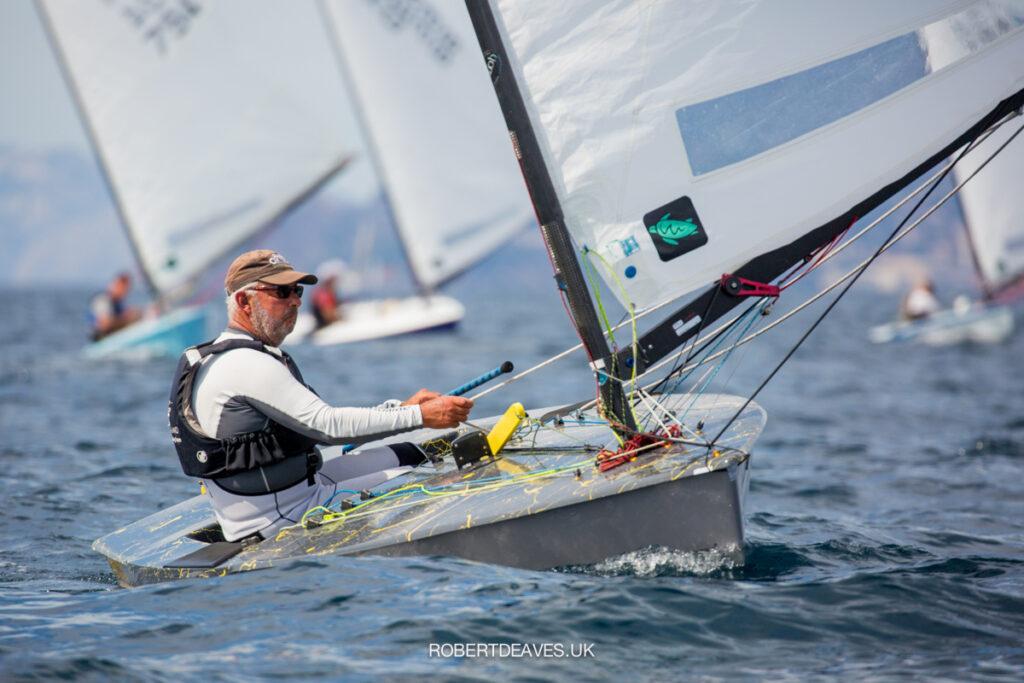 Greg Wilcox sailing downwind, healing the boat to windward.