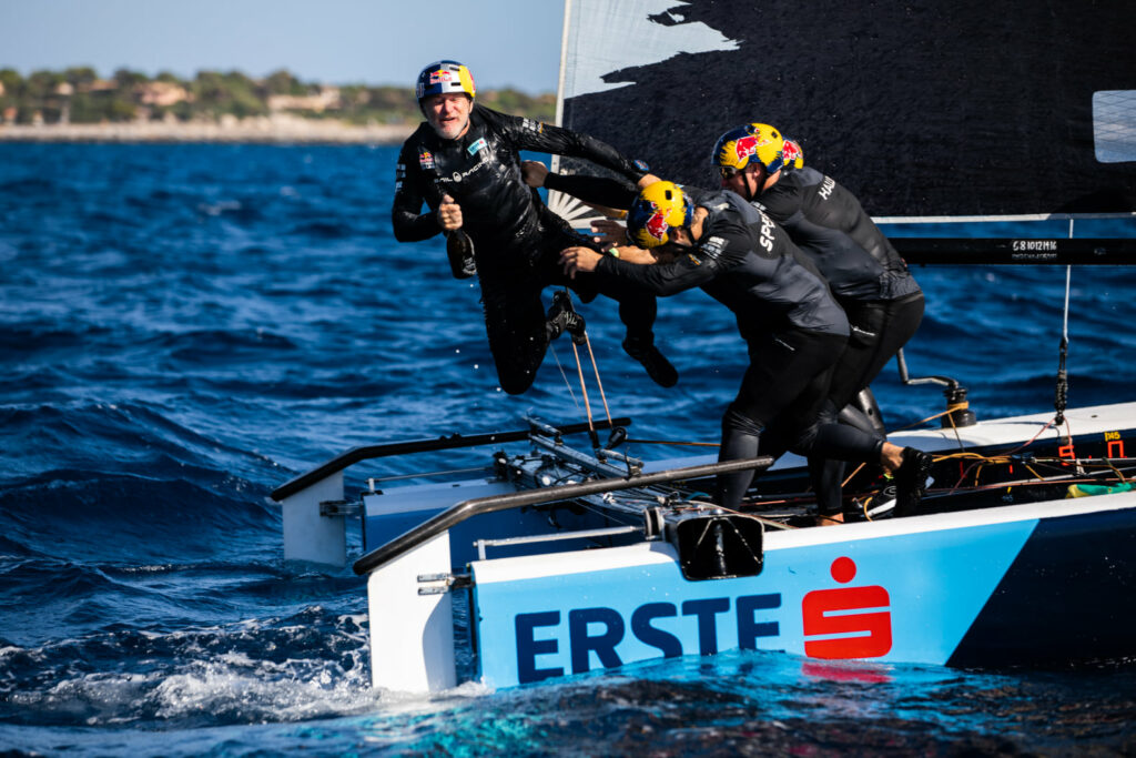 Red Bull's crew pushing skipper Roman Hagara into the water while celebrating their win.