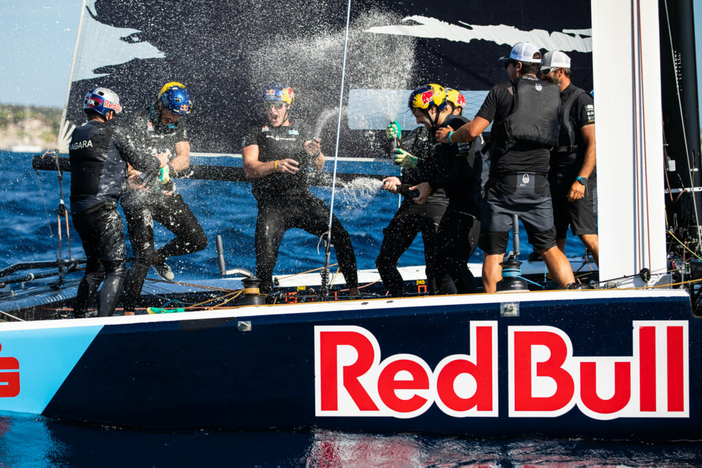 Red Bull Sailing Team celebrating their win on the boat after the final race.