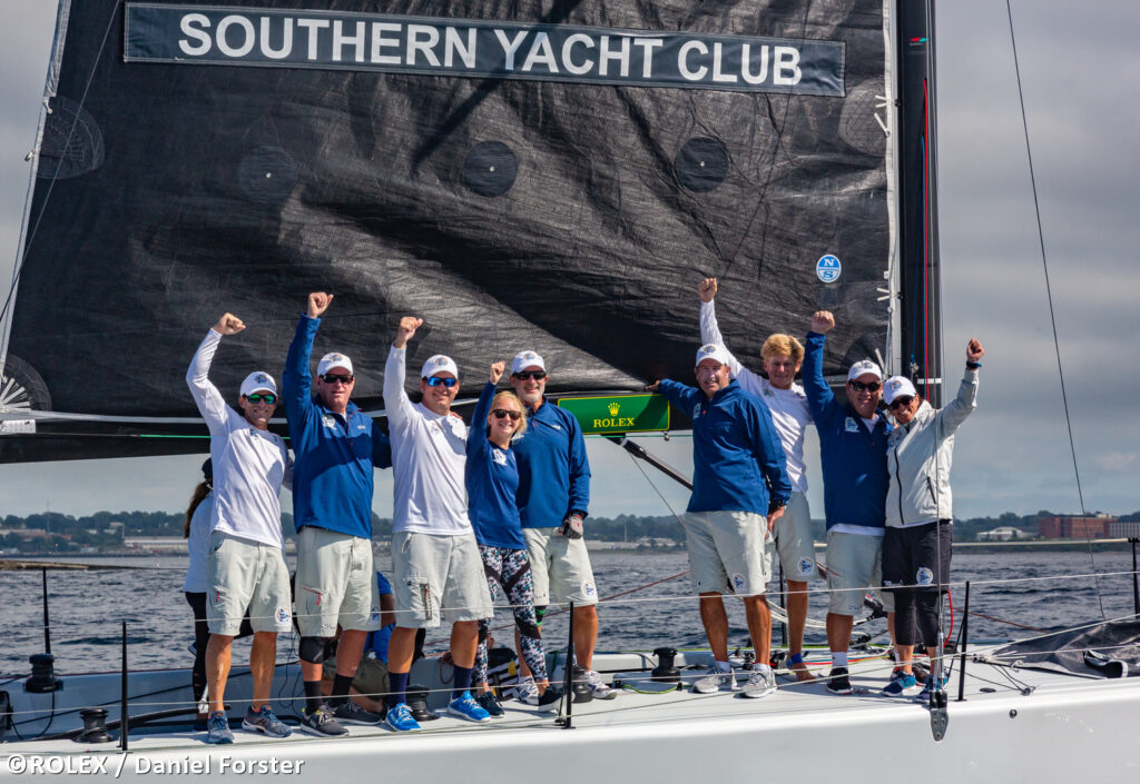 Southern Yacht Club celebrating their win on the boat.