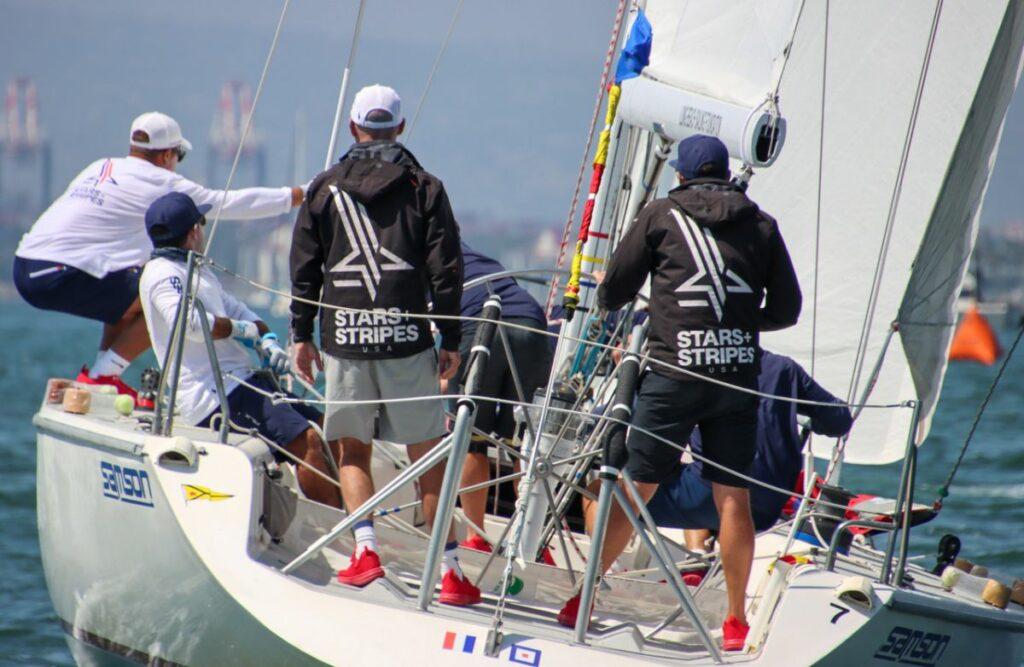 Stern of Stars+Stripes team. Skipper behind the wheel.