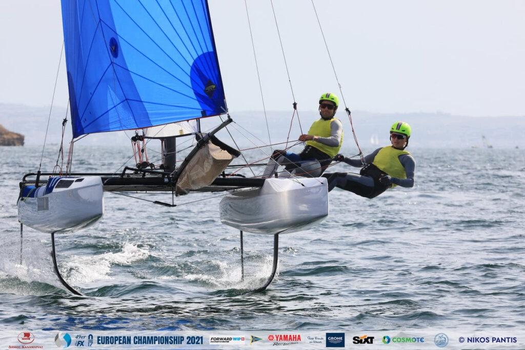 John GimsonandAnna Burnet sailing downwind with spinnaker, while foiling.