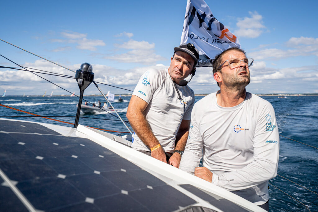 Pascal Bidégorry and Charlie Enright on deck trimming the sails next to the solar pannels.